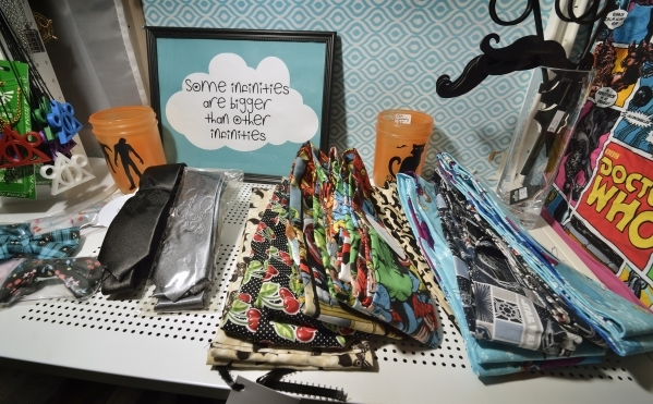 Some of the goods offered by Mad Girl with a Box, a mobile retail business selling geeky merchandise, is shown during a business launch party at High Scores Bar-Arcade at 65 S. Stephanie St. in He ...
