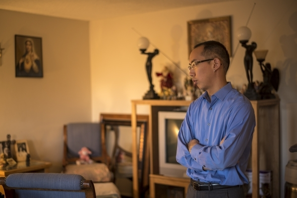Robert Hoo, an advocate with the Nevadans for the Common Good, is interviewed at the home of Marsha Rodriguez in Las Vegas on Tuesday, Nov. 3, 2015. Joshua Dahl/Las Vegas Review-Journal