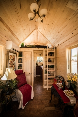 Tumbleweed's Elm model offers optional dormers  in the loft for added space, light, and cross breeze. A storage closet and bookshelves flank the entrance to the kitchen. COURTESY TUMBLEWEED  ...