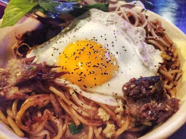 District One Kitchen & Bar, 3400 S. Jones Blvd., Suite 8, offers a variety of Asian dishes, such as the Oxtail Fried Rice served with red onions, soy sauce and a fried egg. The rice can be sub ...
