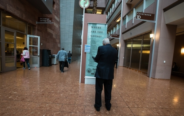 A man looks at a directory in the lobby of the Regional Justice Center in Las Vegas on Wednesday, Nov. 4, 2015. Chase Stevens/Las Vegas Review-Journal Follow @csstevensphoto