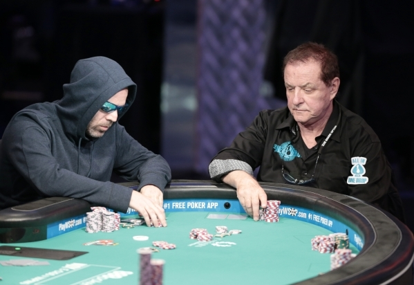 Poker players Ofer Zvi Stern, left, and Pierre Neuville move their chips around during the 2015 World Series of Poker Main Event  in the Penn & Teller Theater at the Rio, 3700 W. Flamingo Rd., ...