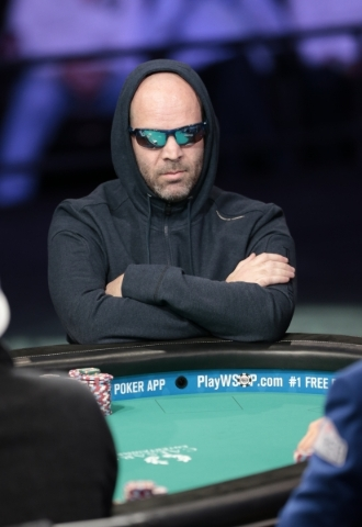 Poker player Ofer Zvi Stern looks across the table as he waits for his cards during the 2015 World Series of Poker Main Event day one, at the Rio, in the Penn & Teller Theater, 3700 W. Flaming ...