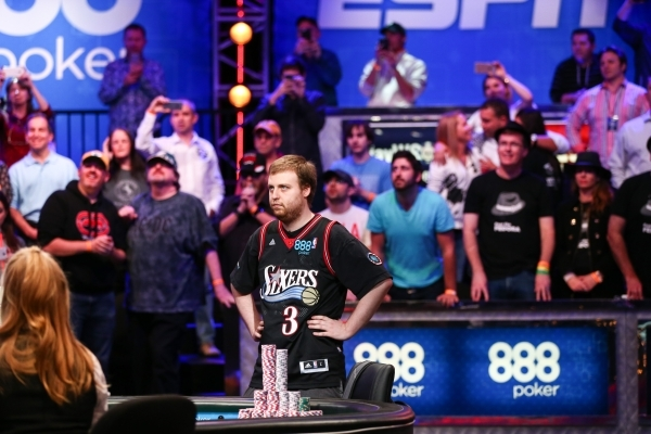 Joe McKeehen of North Wales, Pa., watches the action unfold after Josh Beckley of Marlton, N.J., went all-in during the last day of the final table of the World Series of Poker Main Event at the R ...