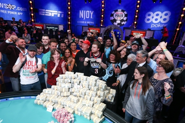 Joe McKeehen of North Wales, Pa., poses with supporters after winning the World Series of Poker Main Event at the Rio hotel-casino in Las Vegas on Tuesday, Nov. 10, 2015. The first place prize inc ...