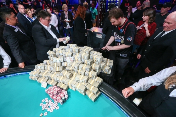Joe McKeehen of North Wales, Pa., puts his championship bracelet away after winning the World Series of Poker Main Event at the Rio hotel-casino in Las Vegas on Tuesday, Nov. 10, 2015. The first p ...