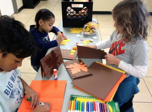 From left, Kane Glucker, his sister Zoe Glucker and Greysen Smith make Thanksgiving cards for seniors Nov. 8 during a ThanksGiving Back program at Casa de Luz, 2412 Tam Drive. The cards are set to ...