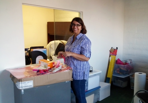 Gabrielle Amato, prevention and education manager at The Rape Crisis Center, 801 S. Rancho Drive, Suite B-2, unpacks inside the nonprofit's new office space. (Special to View)