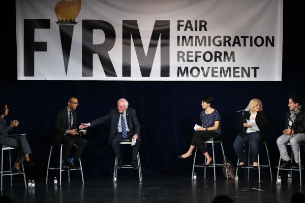 Forum moderator Dorian Warren asks a question to U.S. Sen. Bernie Sanders, I-Vermont, who is running for the Democratic presidential nomination, during an immigration forum hosted by the Fair Immi ...