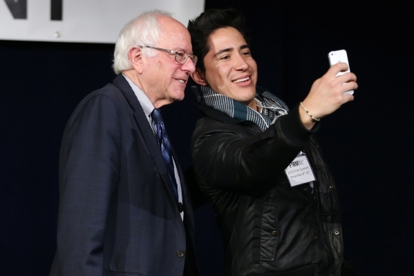 Democratic presidential candidate U.S. Sen. Bernie Sanders, I-Vermont, left, takes a photo with Gustavo Velasco following an immigration forum hosted by the Fair Immigration Reform Movement at The ...