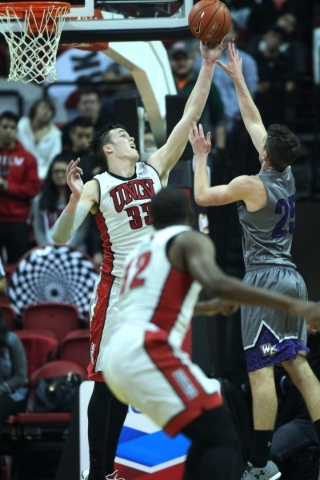 UNLV's Stephen Zimmerman Jr. (33) makes a block against Whittier's Richard Kaye (25) in their men's basketball exhibition game at the Thomas and Mack Center in Las Vegas Friday,  ...