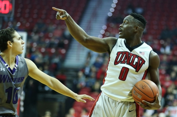 UNLV's Ike Nwamu (0) gestures to a teammate in their men's exhibition game against Whittier at the Thomas and Mack Center in Las Vegas Friday, Nov. 6, 2015. UNLV won 94-57. Erik Verduz ...