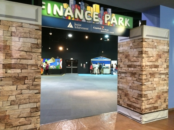 The entrance to the 24-booth exploration room at the Finance Park greets students, seen inside accessing the booths. Booths included groceries, utilities, clothing and transportation, where studen ...