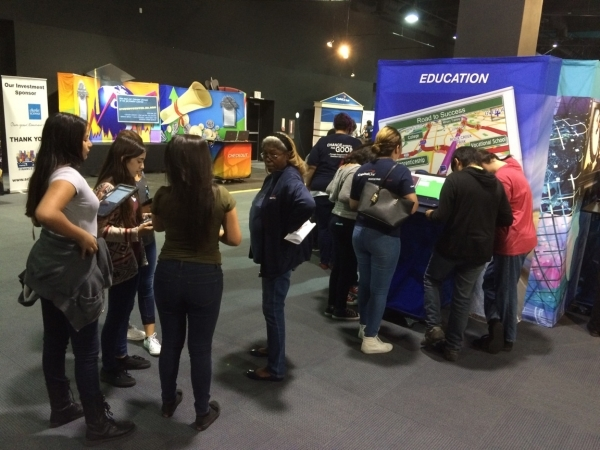 Students gather around the booths where the money earned from their life scenario could be used to buy the essentials of life at the Junior Achievement of Southern Nevada Finance Park. (Jan Hogan/ ...