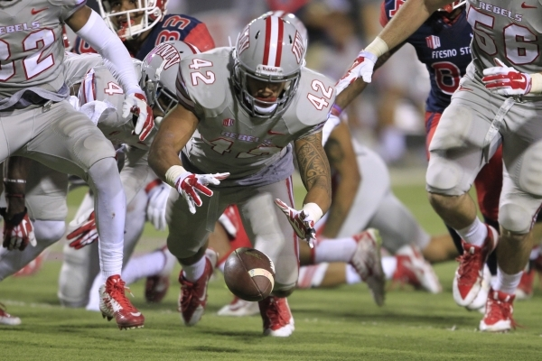UNLV defensive back Peni Vea jumps on a loose Fresno State ball Friday, Oct. 10, 2014 at Sam Boyd Stadium. UNLV won the game in overtime 30-27. (Sam Morris/Las Vegas Review-Journal)
