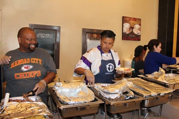 Members of Truth Christian Ministries International serve Thanksgiving brunch in November 2014. This year, the church plans to host its brunch starting at 8 a.m. Nov. 21 at 5101 N. Rainbow Blvd. ( ...