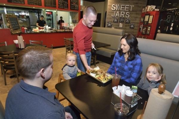 Co-owner Eric Lipsky serves the Duncan family at BellþÄôs BBQ at 10895 S. Eastern Ave. in Henderson on Thursday, Nov. 5, 2015. Bill Hughes/Las Vegas Review-Journal