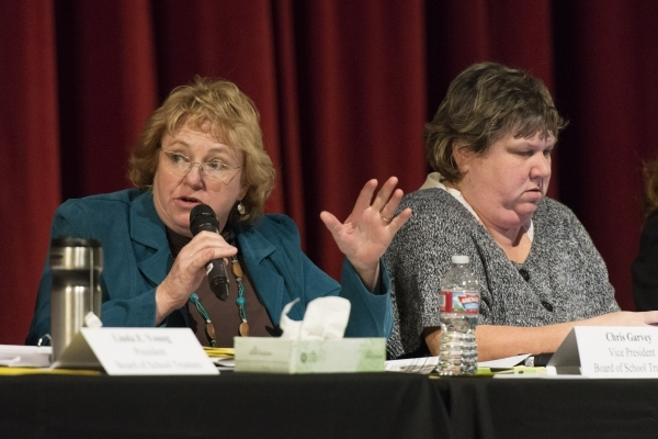 Chris Garvey, vice president of the Board of School Trustees, left, speaks during a meeting to discuss Clark County School District's proposed changes for its sexual education policy at Las  ...