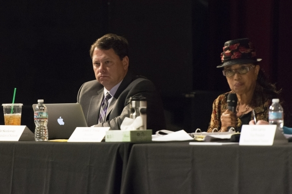 Pat Skorkowsky, superintendent of schools, left, listens to public comment during a meeting to discuss Clark County School District's proposed changes for its sexual education policy at Las  ...