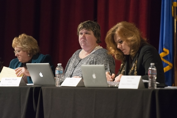 Deanna L. Wright, clerk for the Board of School Trustees, center, listens to public comment during a meeting to discuss Clark County School District's proposed changes for its sexual educati ...