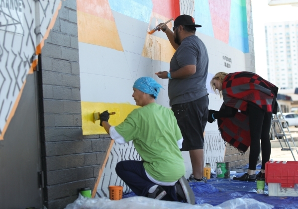 Volunteers help paint Eric Vozzola's design onto the Ukulele Lounge on Friday, Nov, 6, 2015, in Las Vegas. Brett Le Blanc/Las Vegas Review-Journal
