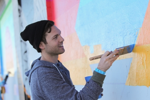 Eric Vozzola paints his design onto the Ukulele Lounge, along with fifty volunteers, on Friday, Nov, 6, 2015, in Las Vegas. Brett Le Blanc/Las Vegas Review-Journal
