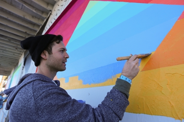 Eric Vozzola paints his design onto the Ukulele Lounge, along with 50 volunteers, on Friday, Nov, 6, 2015, in Las Vegas. Brett Le Blanc/Las Vegas Review-Journal