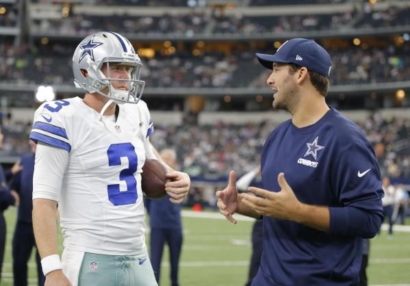 Injured Dallas Cowboys quarterback Tony Romo, right, talks to Dallas Cowboys quarterback Brandon Weeden (3) prior to an NFL football game Sunday, Nov. 1, 2015, in Arlington, Texas. (AP Photo/Brand ...