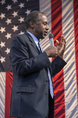 Retired neurosurgeon and Republican presidential candidate, Ben Carson addresses the crowd, during a political rally at the Henderson Pavilion, 200 South Green Valley Parkway, Henderson, NV. Sunda ...
