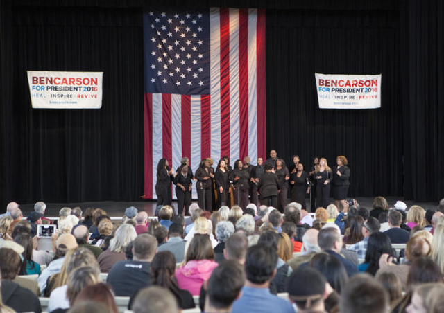 Singers from the Great Inspirations perform prior to the appearance of Republican presidential candidate, Ben Carson, at a political rally at the Henderson Pavilion, 200 South Green Valley Parkway ...