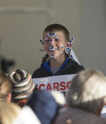 A young fan is seen with stickers on his head prior to the speaking appearance of Republican presidential candidate Ben Carson at a rally at the Henderson Pavilion, 200 South Green Valley Parkway, ...