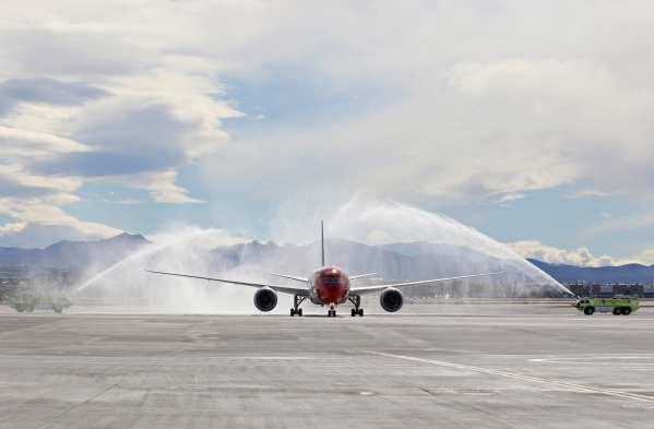 Norwegian Air's first flight from Copenhagen, Denmark, taxis through a ceremonial water cannon shortly after arriving at McCarran International Airport Terminal 3 Tuesday, Nov. 10, 2015, in  ...