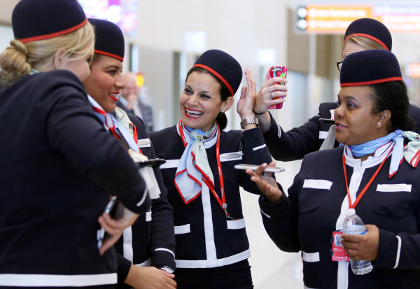 Norwegian Air flight crew from the carrier's first flight from Copenhagen, Denmark, to Las Vegas socialize during a welcome ceremony at McCarran International Airport Terminal 3 Tuesday, Nov ...
