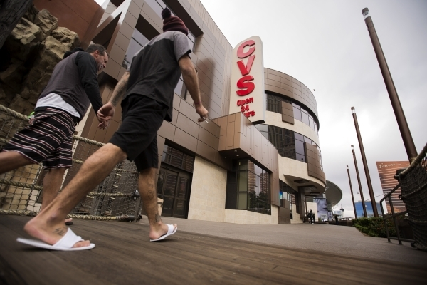 Two men walk pass the CVS store at Treasure Island on Tuesday, Nov. 10, 2015. The Treasure Island announced that  Marvel Comics will open a two story store above CVS Pharmacy based on the Advenger ...