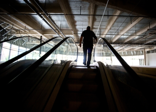 A Treasure Island employee walks up escalators at  the site of of the proposed Marvel Comics store on Tuesday, Nov. 10, 2015. The Treasure Island announced that  Marvel Comics will open a two stor ...