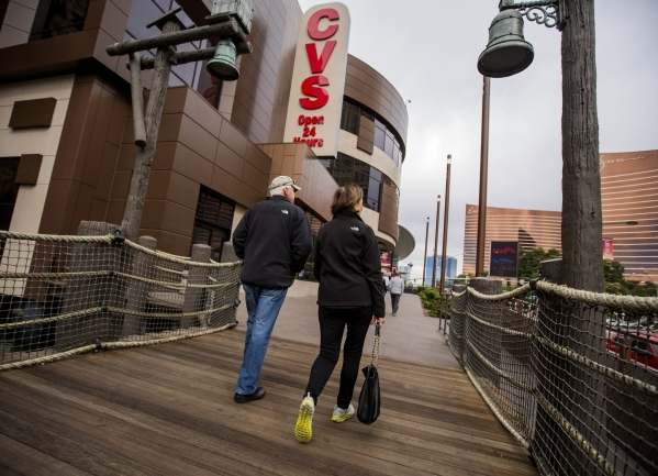 A couple walks pass the CVS store at Treasure Island on Tuesday, Nov. 10, 2015. The Treasure Island announced that  Marvel Comics will open a two story store above CVS Pharmacy based on the Adveng ...