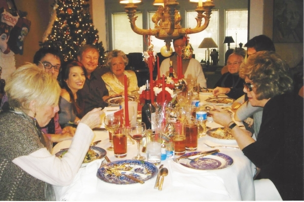 Wes Winters, seated at the head of the table enjoys a holiday dinne with friends in his east valley home. (Specail to View)
