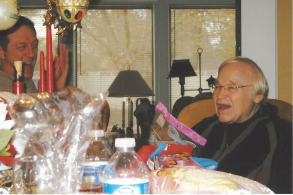 Wes Winters,  enjoys a laugh with friend the now departed Jerry Ritzholts at a holiday dinner with friends in his east valley home. (Specail to View)