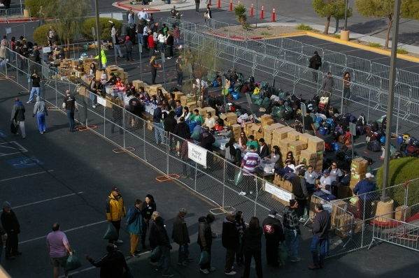 Attendees wait in line for food and clothing during the 2014 Blessfest at Calvary Chapel Spring Valley. (Special to View)