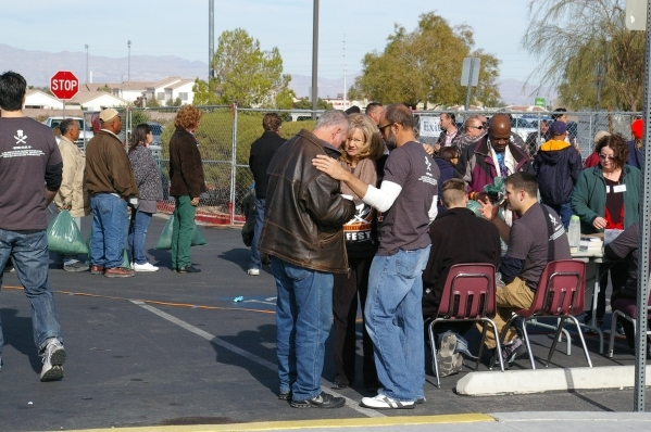 Calvary Chapel members speak with an attendee at the 2014 Blessfest. More than 1,000 volunteers help provide meals, clothing, medical, dental, optical services and more to people who are homeless  ...