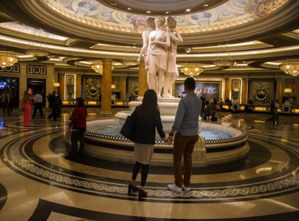 A couple views a statue at the entrance of Caesars Palace, 3570 S. Las Vegas Boulevard  on Monday, Nov. 9,2015 Jeff Scheid/ Las Vegas Review-Journal Follow @jlscheid