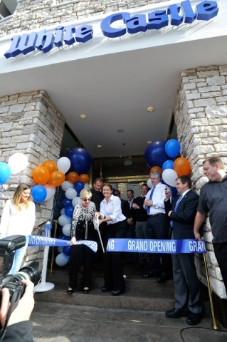 Clark County Commissioner Chris Giunchigliani, left and Lisa Ingram, president of White Castle, cut a ceremonial ribbon prior to the opening of the hamburger chain's newest on the Strip on T ...