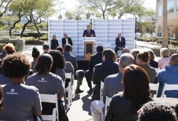 Barclaycard US employees listen as Craig Peters, Interim global chief operations and technology officer at Barclaycard, speaks during a special event outside the newly built 35,000-square-foot bui ...