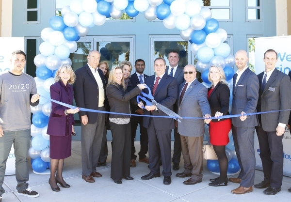 Attendees, including Craig Peters, interim global chief operations and technology officer at Barclaycard, center, Kristin Mcmillan, president and CEO of the Las Vegas Metro Chamber of Commerce, se ...
