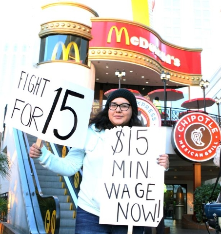 UNLV student Emily Almaguer joined local fast-food, home care, and child care workers as they protest outside a McDonald's on the Strip at 3475 Las Vegas Blvd. South Tuesday, Nov. 10, 2015.  ...