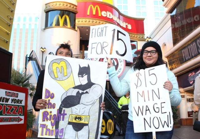 UNR student Monique Normand, left, and UNLV student Emily Almaguer joined the local fast-food, home care, and child care workers as they protest outside a McDonald's on the Strip at 3475 Las ...