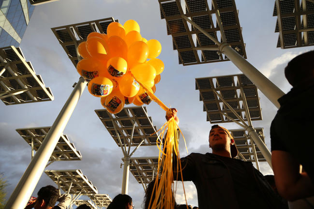 Emiliano Alvarez holds balloons during a Fight For $15 rally in front of Las Vegas City Hall in Las Vegas Tuesday, Nov. 10, 2015. Fast food workers and supporters demand for a $15 hourly wage and  ...