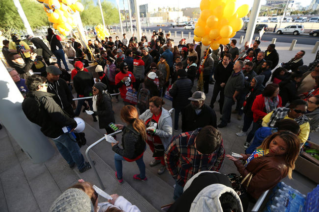 People gather in front of Las Vegas City Hall during a Fight For $15 rally Tuesday, Nov. 10, 2015 in Las Vegas. Fast food workers and supporters demand for a $15 hourly wage and union rights. Erik ...