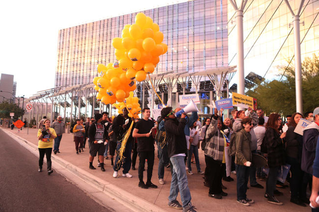 People march during a Fight For $15 rally in front of Las Vegas City Hall in Las Vegas Tuesday, Nov. 10, 2015. Fast food workers and supporters demand for a $15 hourly wage and union rights. Erik  ...