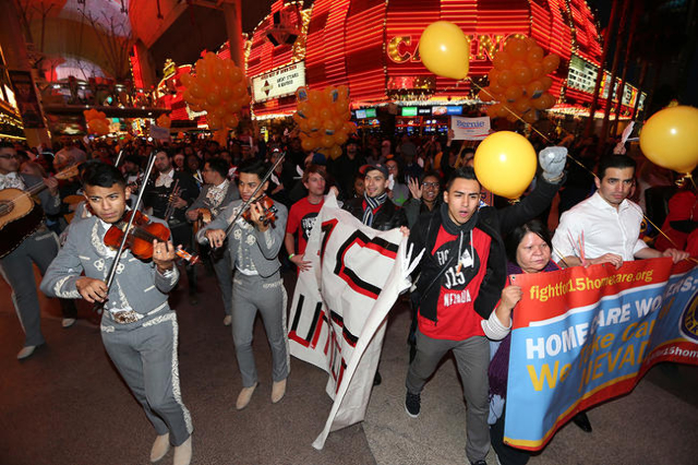 Demonstrators march on Fremont Street to McDonald's inside The D Las Vegas casino-hotel for a Fight For $15 rally Tuesday, Nov. 10, 2015 in Las Vegas. Fast food workers and supporters demand ...